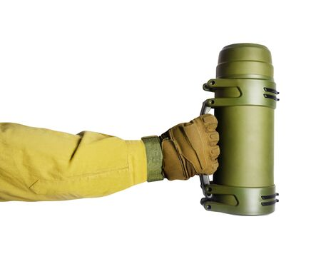 Isolated  of arm in tactical glove and olive jacket holding green .