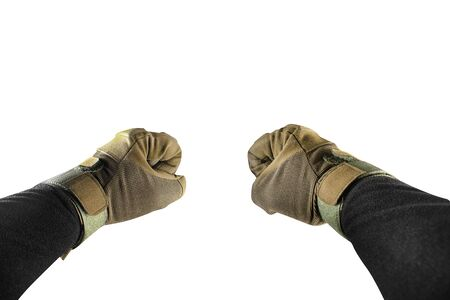 Isolated first person view photo of arm fists in tactical gloves and black jacket.