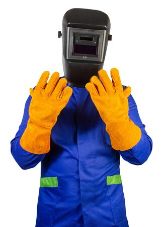 Isolated photo of a fully equipped welder in robe, mask and orange protective gloves standing on white background.