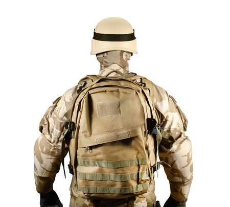 Isolated photo of a fully equipped soldier in uniform, armor, helmet and backpack standing rear view.