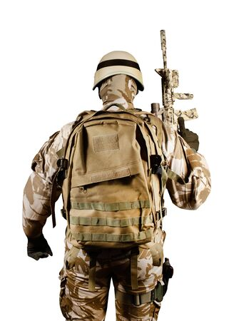 Isolated photo of a fully equipped soldier in uniform, armor, helmet, backpack and rifle standing rear view.