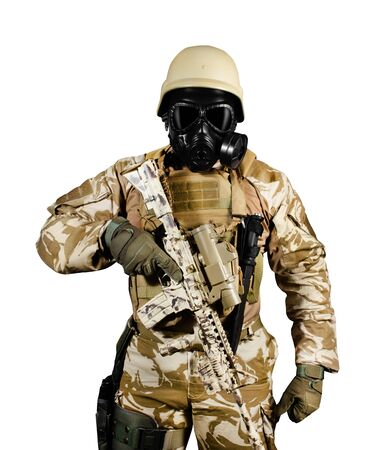 Isolated photo of a fully equipped soldier in uniform, armor, helmet and gas mask standing with rifle on white background front view.