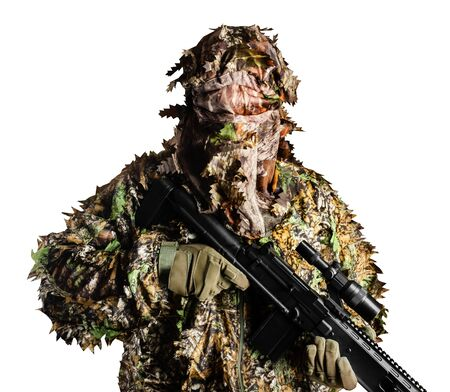 Photo of a forest camouflaged suit soldier standing and holding sniper rifle isolated on white background. Stockfoto - 148397205