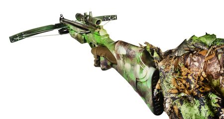 Isolated photo of a first person view hunter hand in forest camouflaged suit holding crossbow on white background side view.