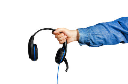 Photo of isolated male hand in shirt holding gaming headphones.