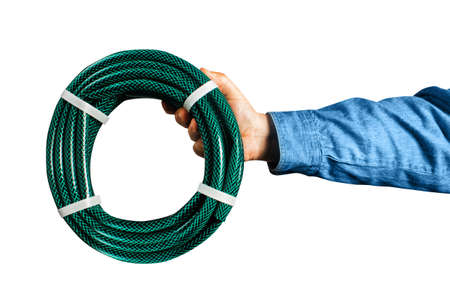 Photo of isolated male hand in shirt holding water green garden hose. Stockfoto