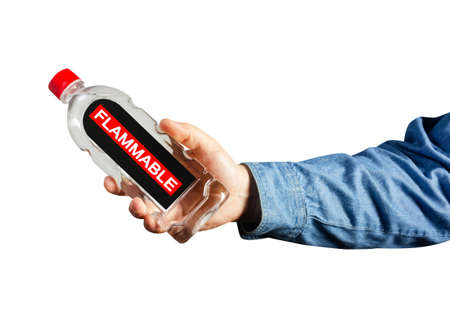Photo of isolated male hand in shirt holding flammable liquid bottle. Stockfoto