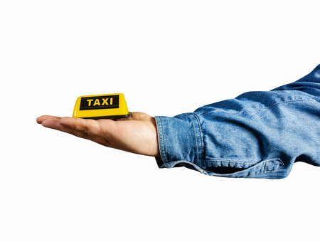 Photo of isolated male hand in shirt holding taxi sign profile view. Stockfoto