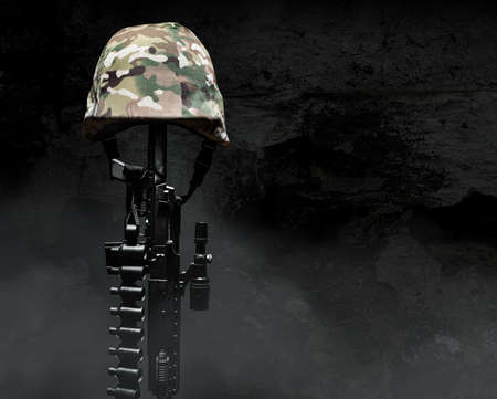 Photo of a camouflaged soldier armor helmet with rifle on dark background with fog.