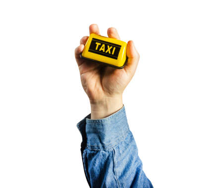 Photo of isolated male hand in shirt holding taxi sign. Stockfoto