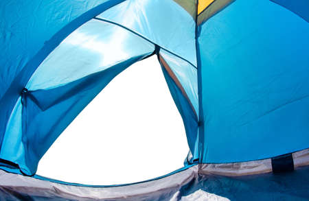 Photo of a white isolated copyspace from a blue camping tent door angle view.