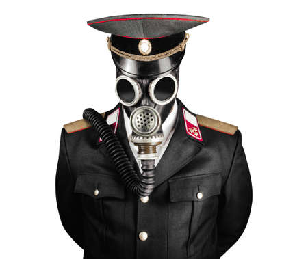 Isolated photo of a post apocalyptic military officer in uniform suit and peaked cap standing in soviet gas mask on white background.