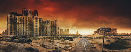 Evening post apocalyptic background image of desert city wasteland with abandoned and destroyed buidings, cracked road and sign. Stockfoto