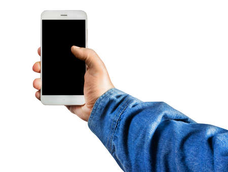 Isolated first person view photo of a male hand in jeans shirt holding a smartphone vertically on white background.