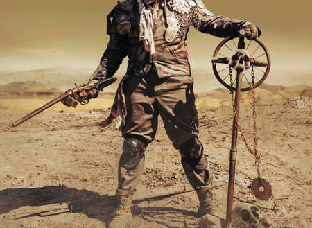 Photo of a post apocalyptic raider warrior in leather jacket with metal armor and shotgun weapon standing in wasteland with skull cross sign.