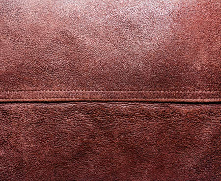 Background photo of brown suede texture with seam. Stockfoto