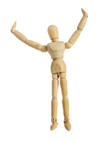 Isolated photo of a wooden dummy mannequin figurine with hands up on white background. Stockfoto