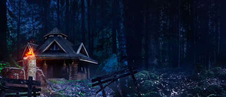 Horror background image of fantasy witch house in night  woods with magic totem with symbols.