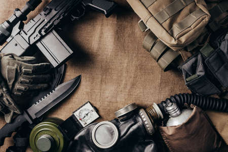 Photo of post apocalyptic stalker soldier ammunition laying on table upper view. Stockfoto
