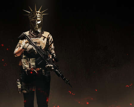 Photo of female soldier in ammunition and Statue of Liberty golden mask holding rifle on dark background front view.