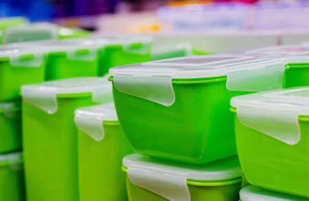 Photo of green plastic containers standing in store.