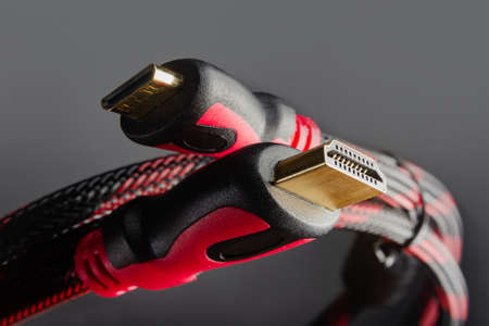 Photo of red colored hdmi cables close-up.