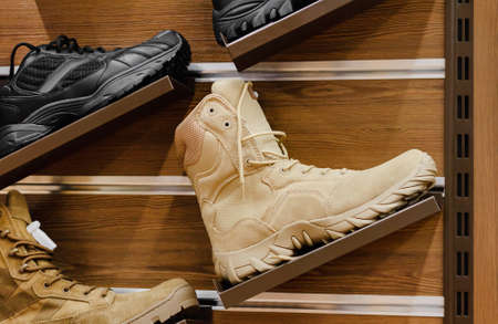 Photo of military store with different soldier and tactical boots and footwear stand. Stockfoto