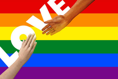 Isolated female hands in reaching to each other gesture with LGBT pride flag and love word.