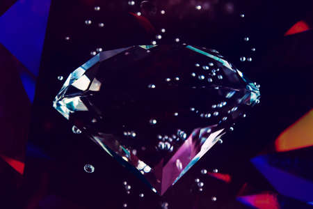 Photo of dark toned diamond under water with air bubbles and color glow.