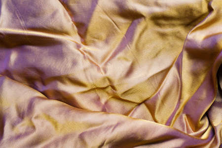 Texture backdrop photo of orange colored synthetic silk cloth material. Banque d'images