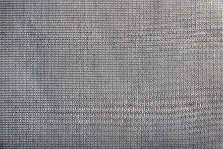 Texture backdrop photo of grey colored synthetic cloth texture.