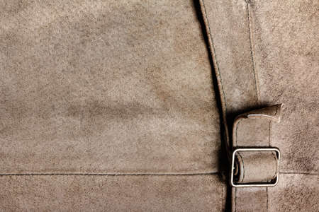 Texture backdrop photo of brown colored suede leather surface with belt. Banque d'images