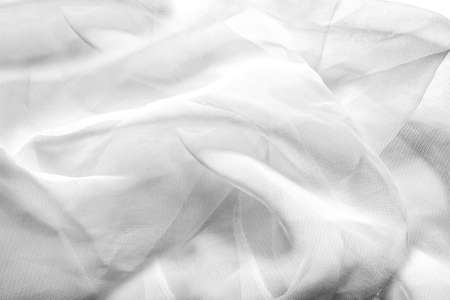 Texture backdrop photo of white colored net folded cloth.
