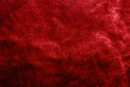 Backdrop texture photo of red colored velvet material cloth.