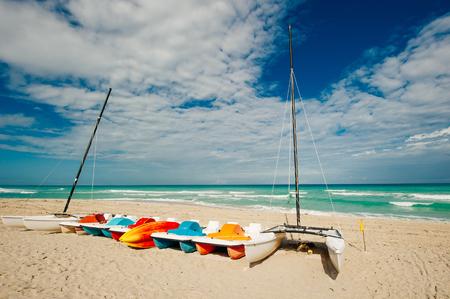Colorful fishing boats hauled ashore on Beach