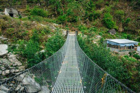 Hanging suspension bridge in himalaya Nepal. Stok Fotoğraf