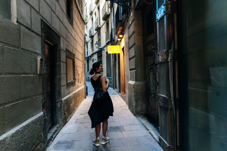 Woman staiding on old street of Barcelona, Spain