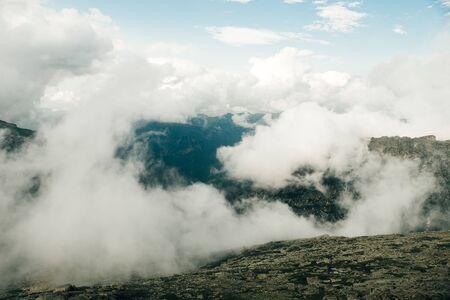 white clouds along the stone mountains. Yergaki