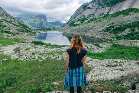 Woman in mountains with beautiful nature background