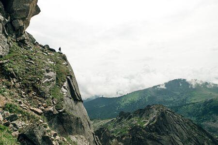 Silhouette of a champion on mountain peak. Active life Stok Fotoğraf
