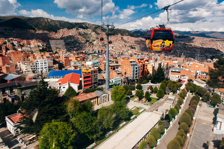 Cable cars or funicular system over orange roofs and buildings of the Bolivian capital, La Paz, Bolivia