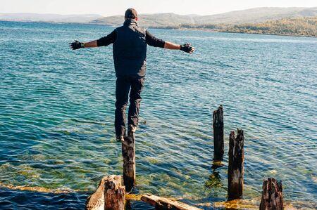 man on Rock on Olkhon Island in Lake Baikal