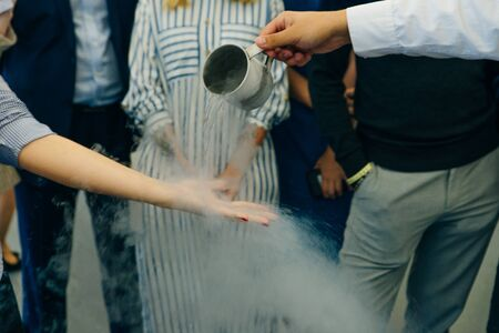 Chemical event at the birthday party: children's hands touch the smoke from liquid nitrogen. The view from the top. Standard-Bild - 131807681