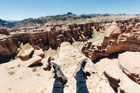 Girl Watching over Charyn Canyon in South East Kazakhstan feet Reklamní fotografie
