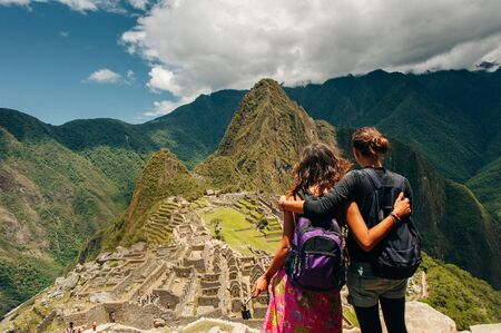Couple looking at the Lost city of the Incas, Machu Picchu, 스톡 콘텐츠