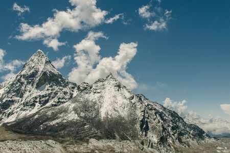The himalayan peaks on blue sky background in the Everest region on a sunny day - Nepal,