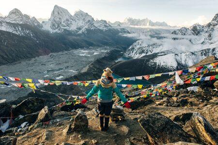 Female Tourist Hikking at gokyo ri mountain peak near gokyo lake during Everest base camp trekking