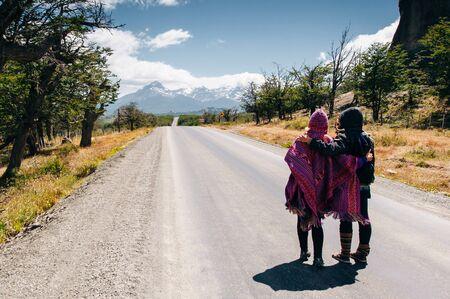 tourists on the road Фото со стока - 131807643