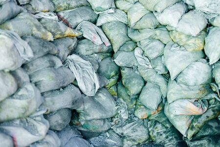 Warehouse bags full of cement and building sand
