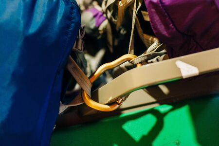 menallic products for the clothing industry. carabiner in color nickel in one copy which is used for fastening of a belt to a backpack